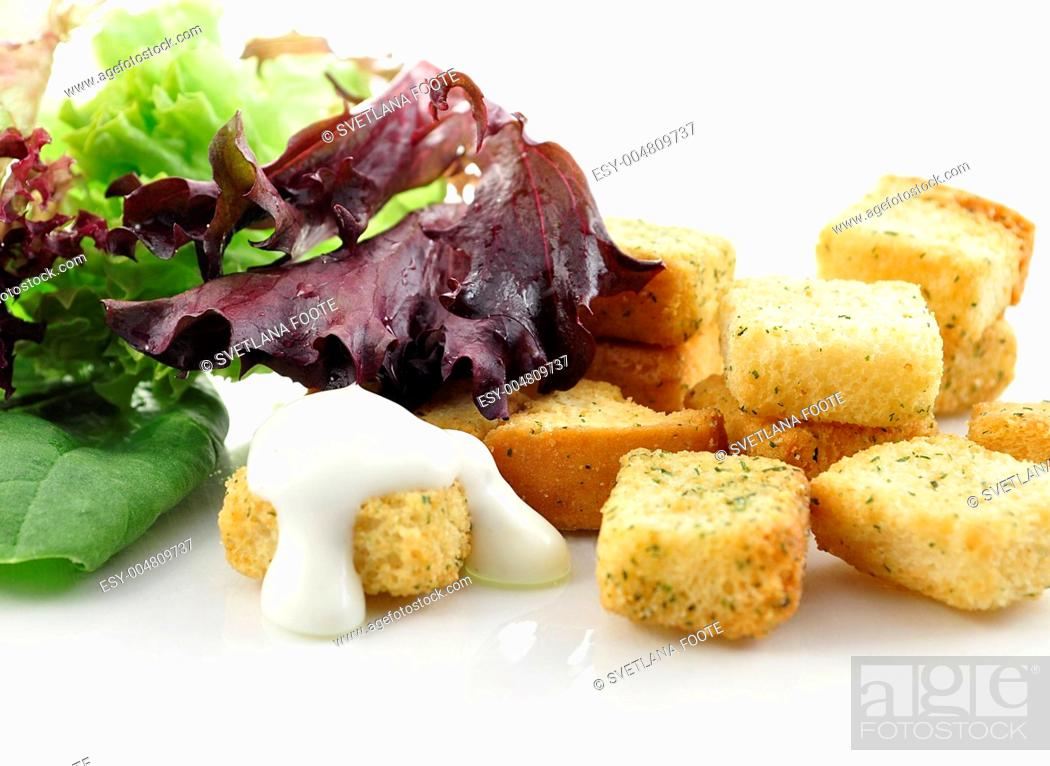 Stock Photo: croutons and salad leaves.