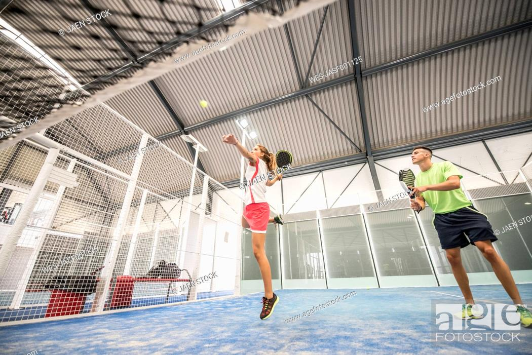 Stock Photo: Two paddle tennis players on court playing a match.