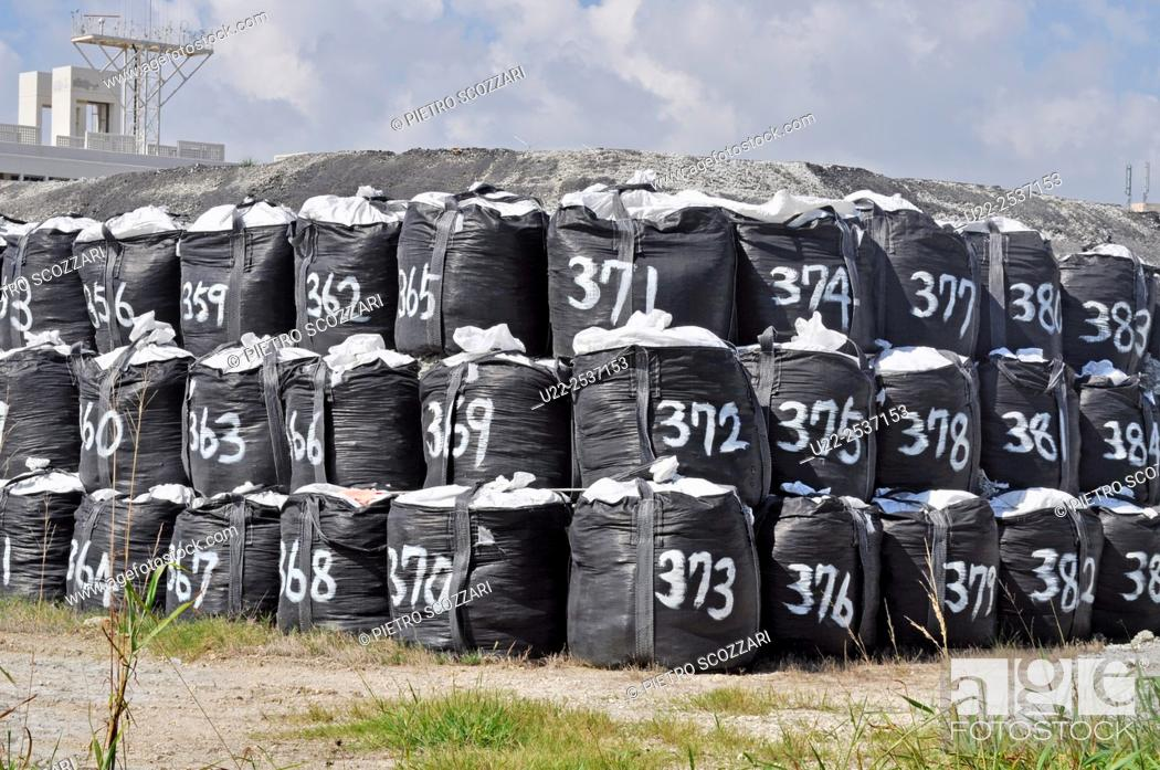 Stock Photo: Tomishiro, Okinawa, Japan: huge numbered bags filled with construction materials.