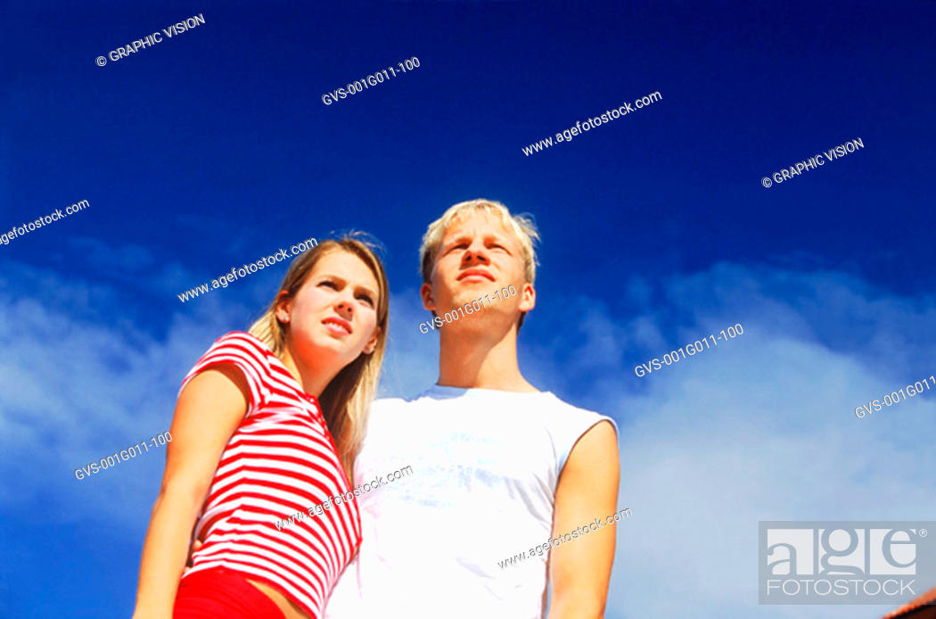 Stock Photo: Young couple standing outdoors.