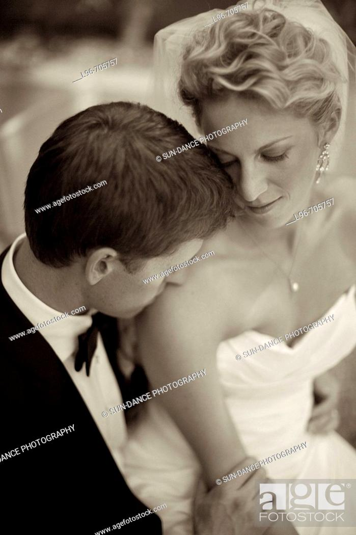 Stock Photo: gorgeous couple just married, stealing a private embrace / kiss.