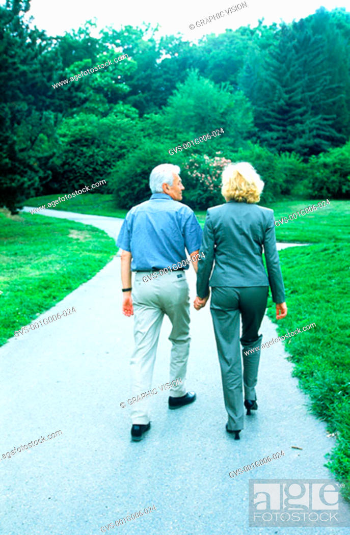 Stock Photo: Elderly couple walking in a garden.