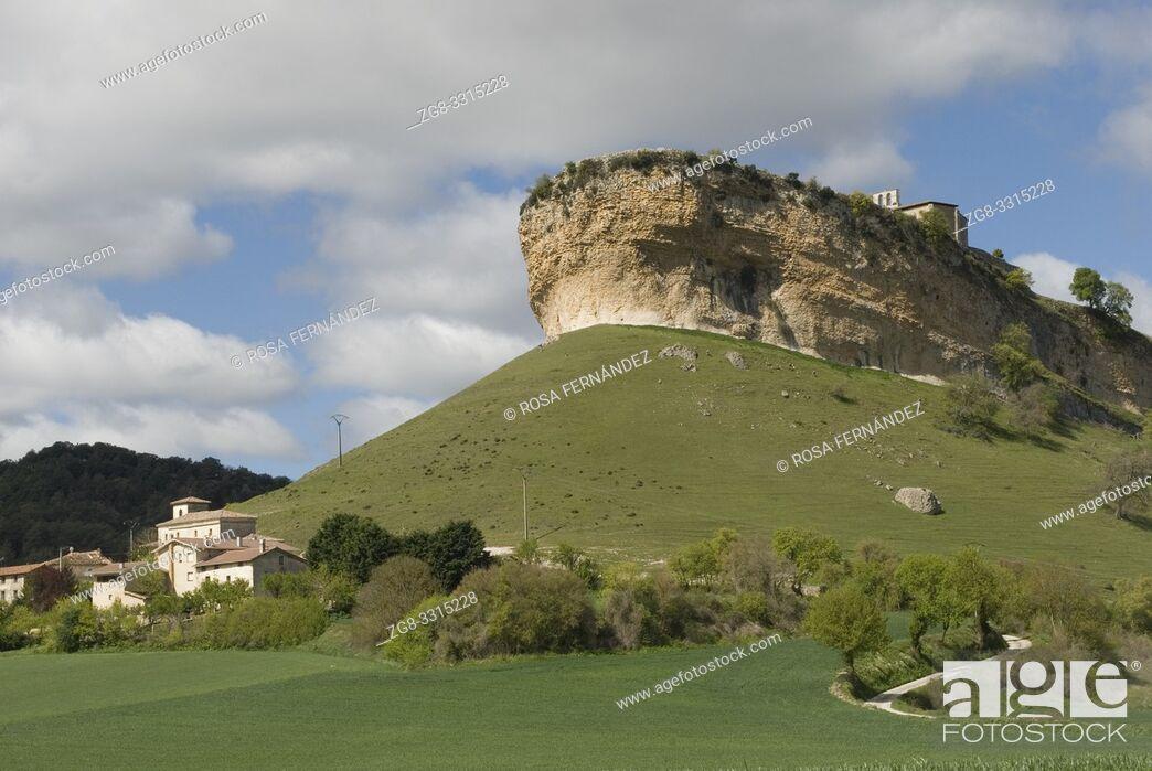 Stock Photo: Village of San Pantaleon de Losa and peculiar limestone formation of Peña Colorada, Valley of Losa, Las Merindades, province of Burgos, Castilla y Leon, Spain.