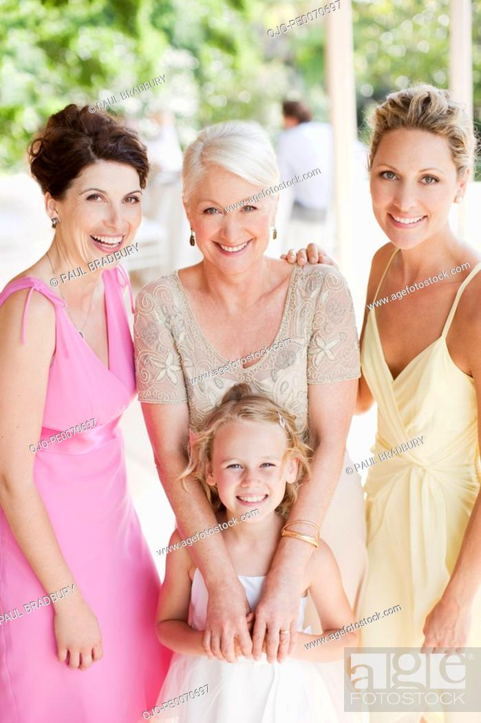 Stock Photo: Flower girl and bridal party smiling.