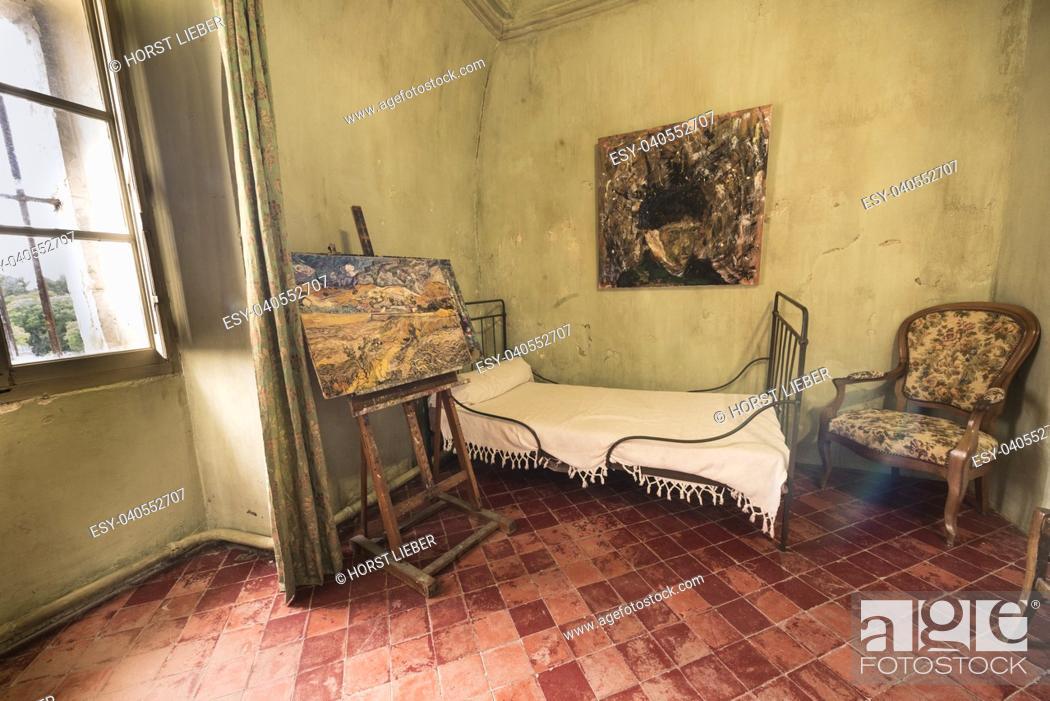 Stock Photo: St Remy de Provence, Bouches du Rhone, France, 06. 24. 2018. Reconstruction of Vincent Van Goghâ. . s room in the monastery of St. Paul de Mausole.