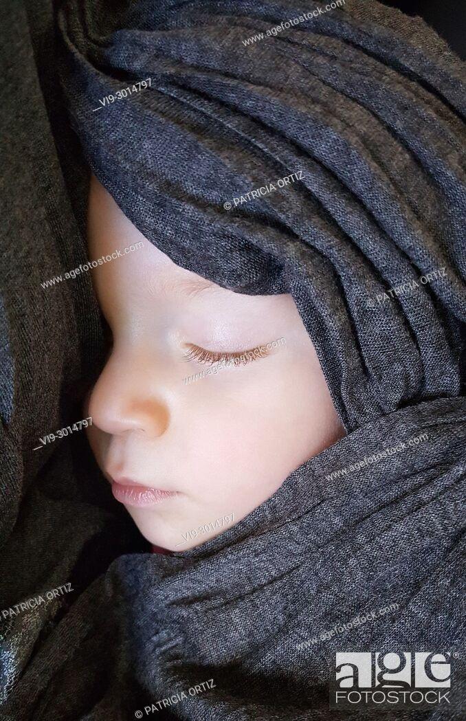 Stock Photo: Wrapped baby sleeping.