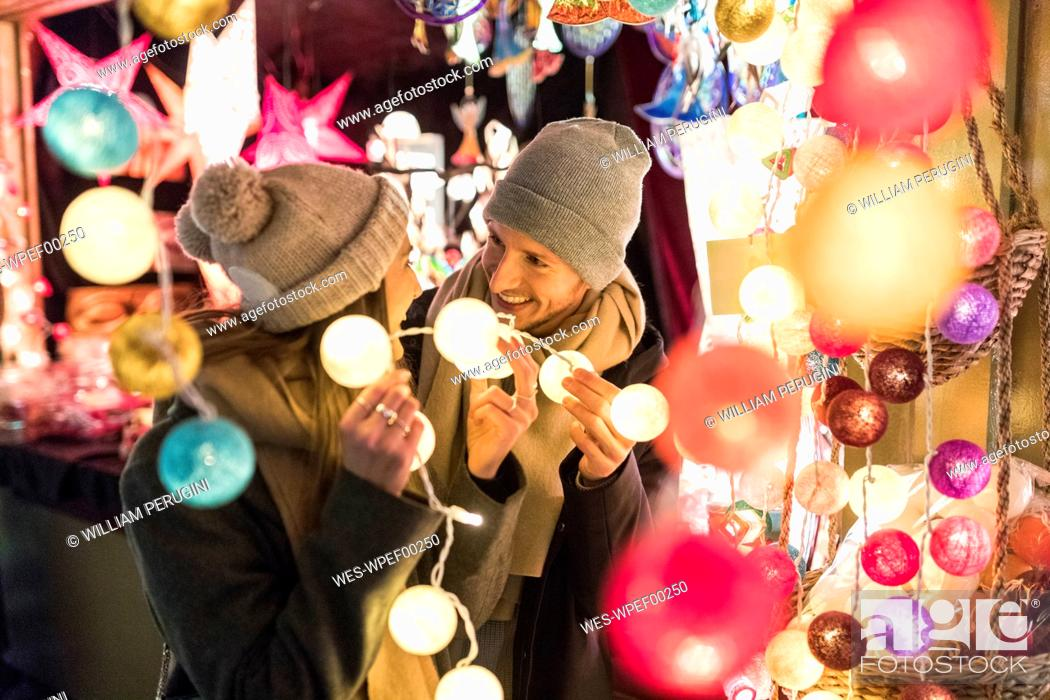 Stock Photo: Young couple watching offerings at Christmas market.