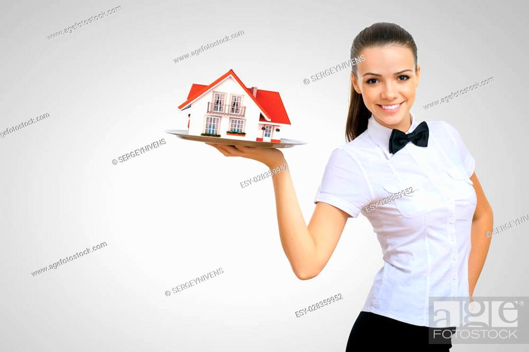 Photo de stock: Waitress in white shirt with a tray and house on it.