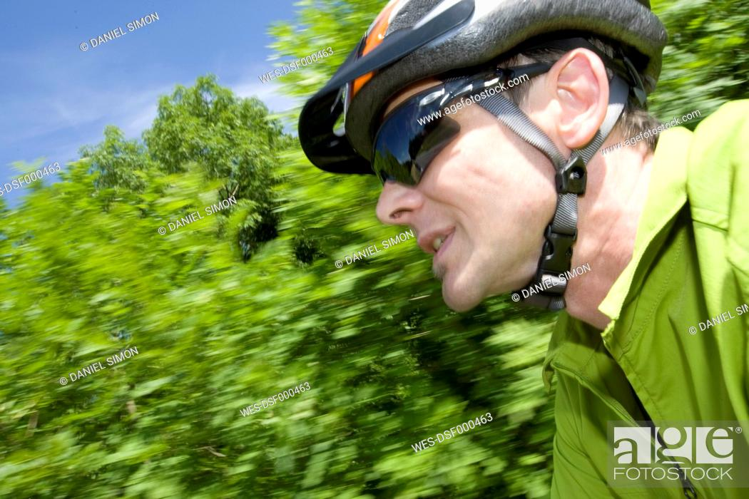 Stock Photo: Germany, Bavaria, Mature man with cycling helmet.