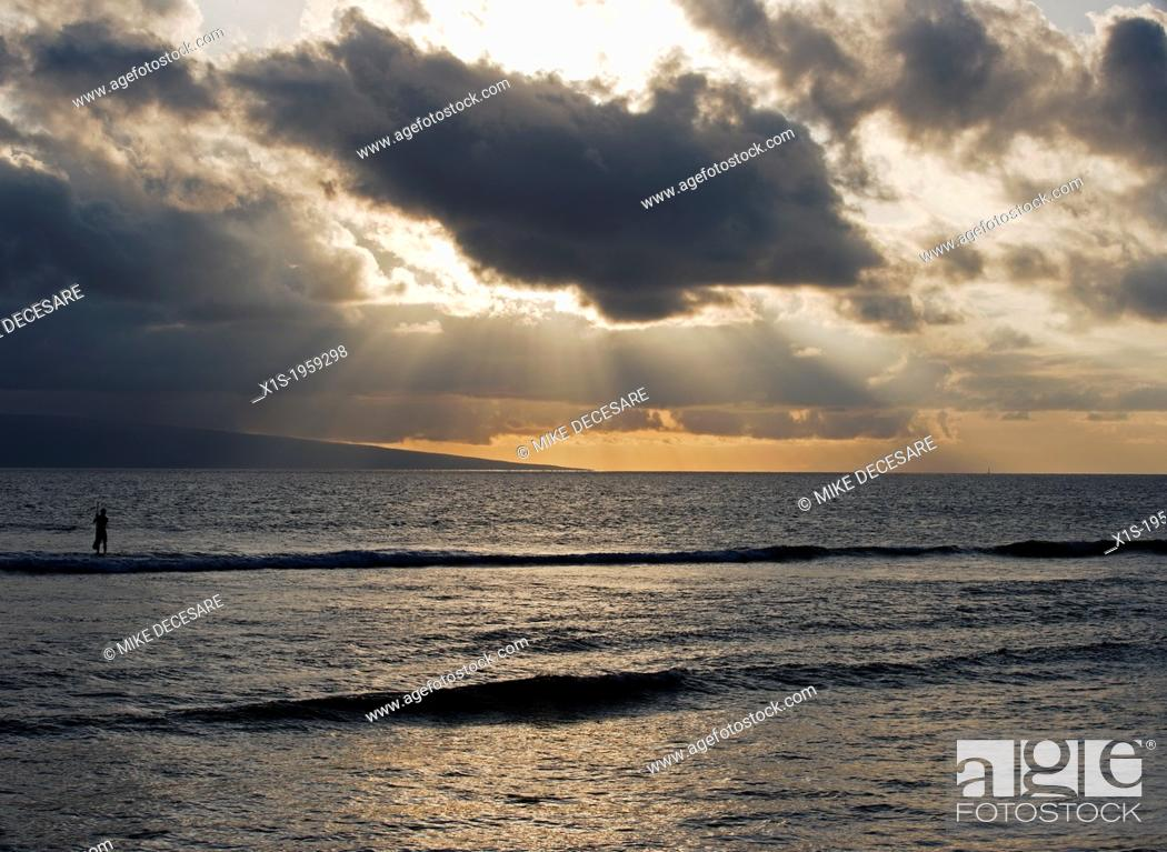 Stock Photo: Paddle board surfer in the Pacific Ocean off the coast of Maui at sunset.