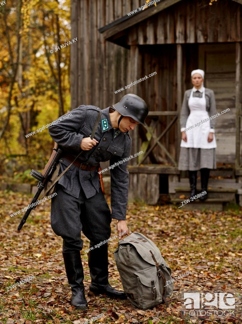 Stock Photo: Historic costume theme World War II, Finnish soldier and the Lotta. Photographed in the Ragvalds museum area in Kirkkonummi, Finland.