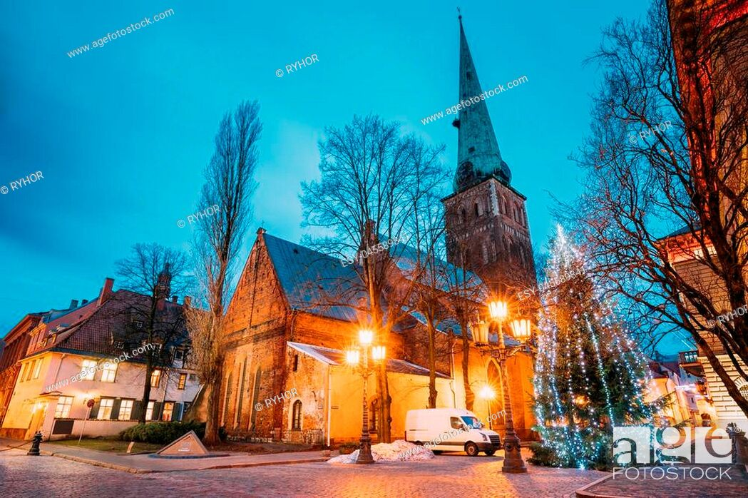 Stock Photo: Riga, Latvia. Cathedral Basilica Of St. James, Pyramidal Monument To Barricades And Perished People On January 20, 1991 And Holiday Xmas Christmas Tree At.