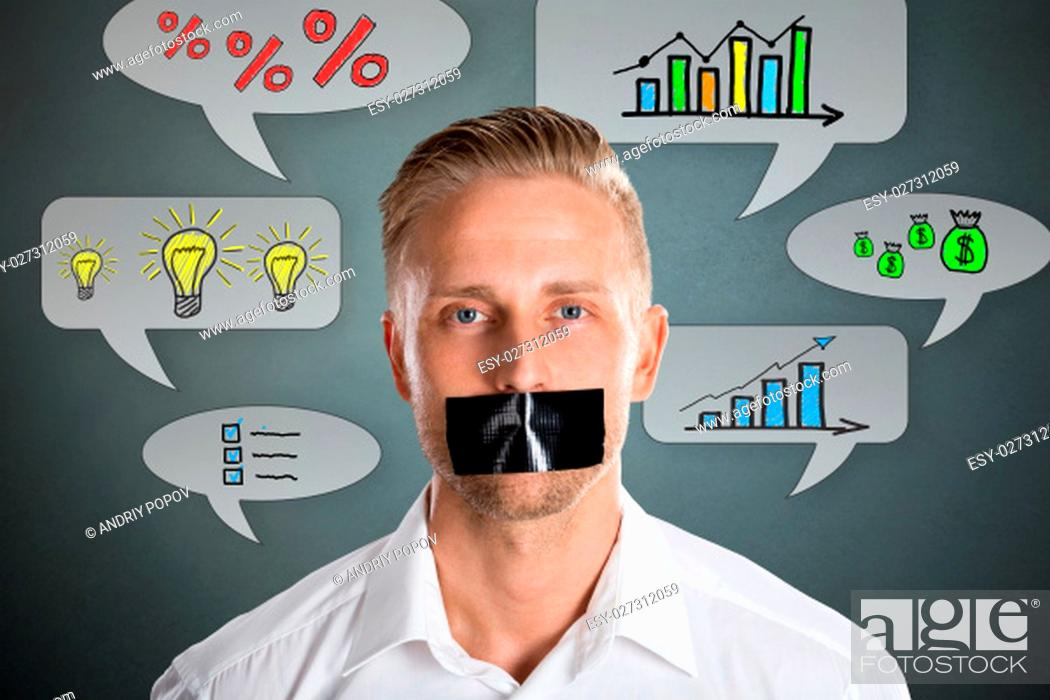 Stock Photo: Businessman With Black Duct Tape Over His Mouth With Business Symbol At Background.