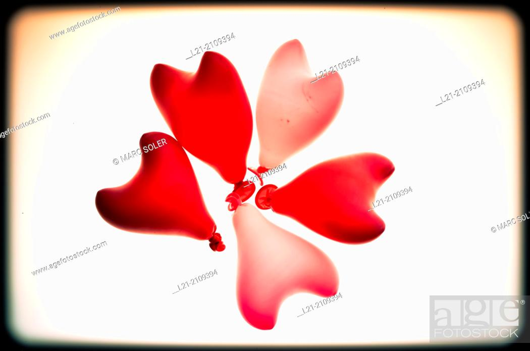 Stock Photo: Group of five heart red shaped balloons.