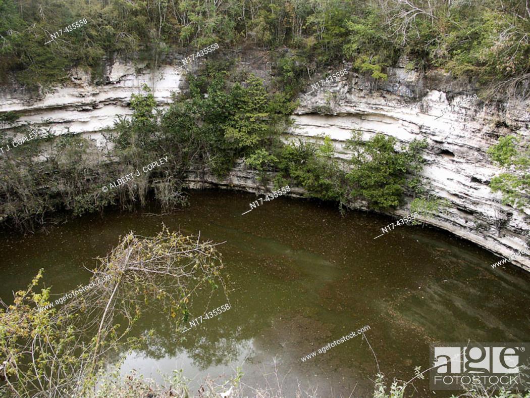 Stock Photo: Sacred Cenote, Mayan ruins of Chichen Itza. Yucatan, Mexico.