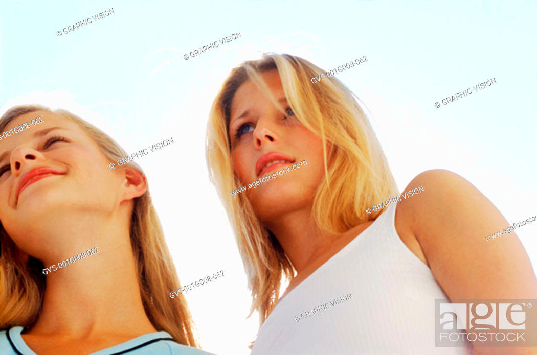 Stock Photo: Low angle view of two young women.