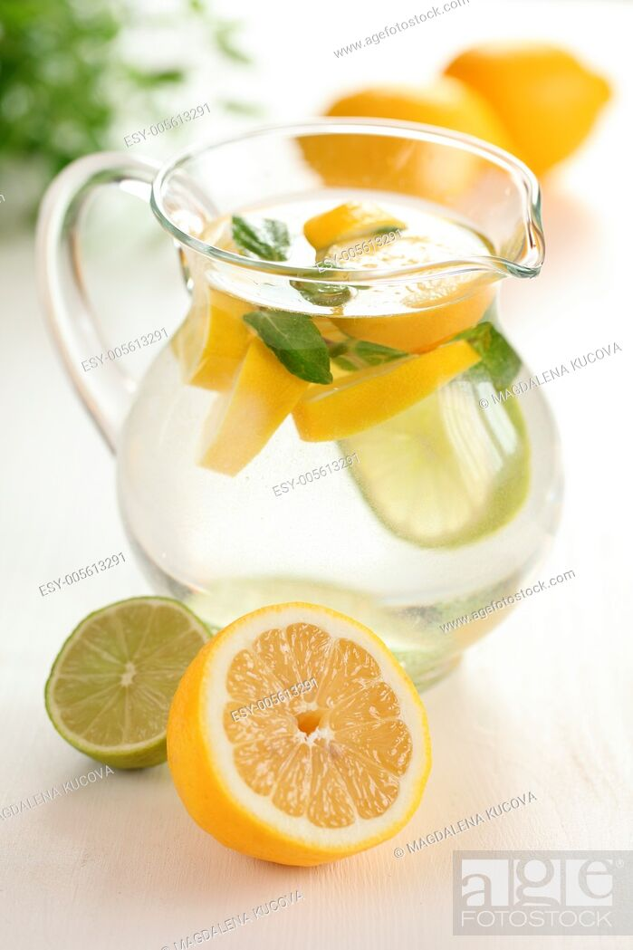 Stock Photo: Jug of fresh lemon lemonade with mint leaves.