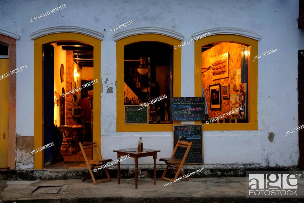 Stock Photo: Inviting restaurant in Paraty's historic center; Paraty, Espirito Santo, Brazil. The beautiful colonial town of Paraty has been a UNESCO World Heritage Site.