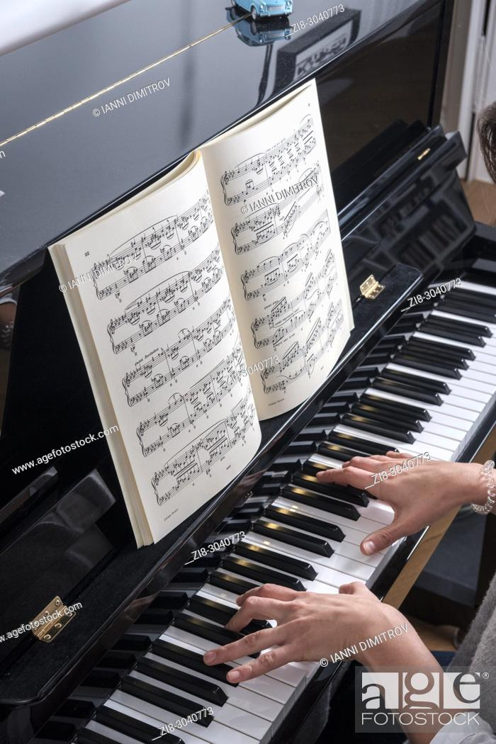 Stock Photo: Woman plays classical music on a piano -top view.