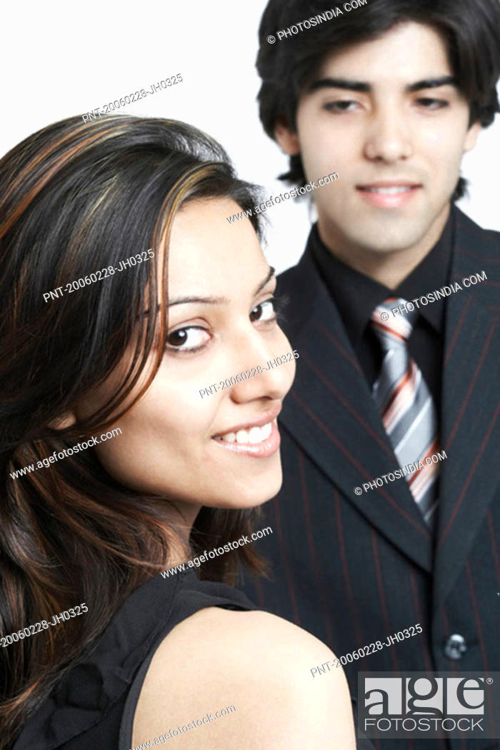 Stock Photo: Portrait of a businesswoman looking over her shoulder.