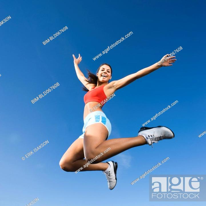 Stock Photo: Native American woman jumping in mid-air.
