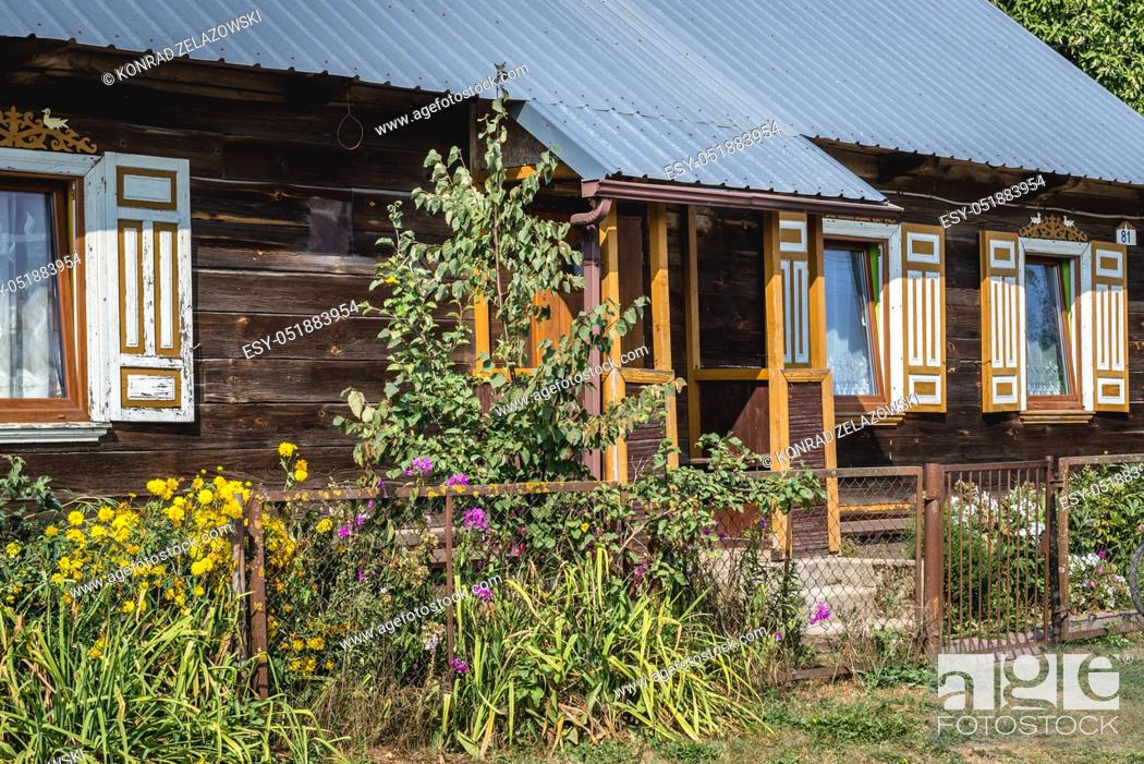 Stock Photo: Wooden house in Soce village on so called The Land of Open Shutters trail, famous for traditional architecture in Podlaskie Voivodeship, Poland.