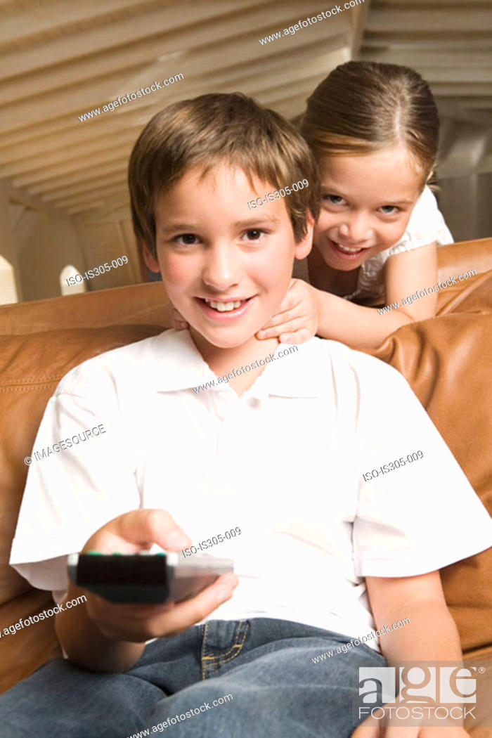 Stock Photo: Sister and brother with remote control.