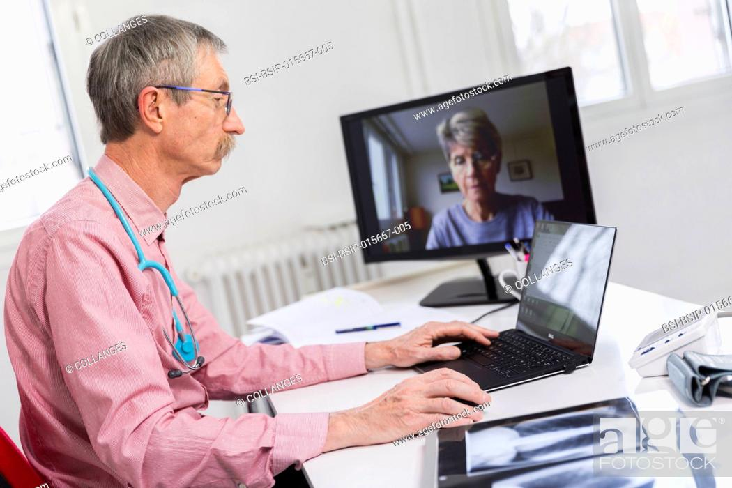 Stock Photo: Medical teleconsultation with senior female patient.