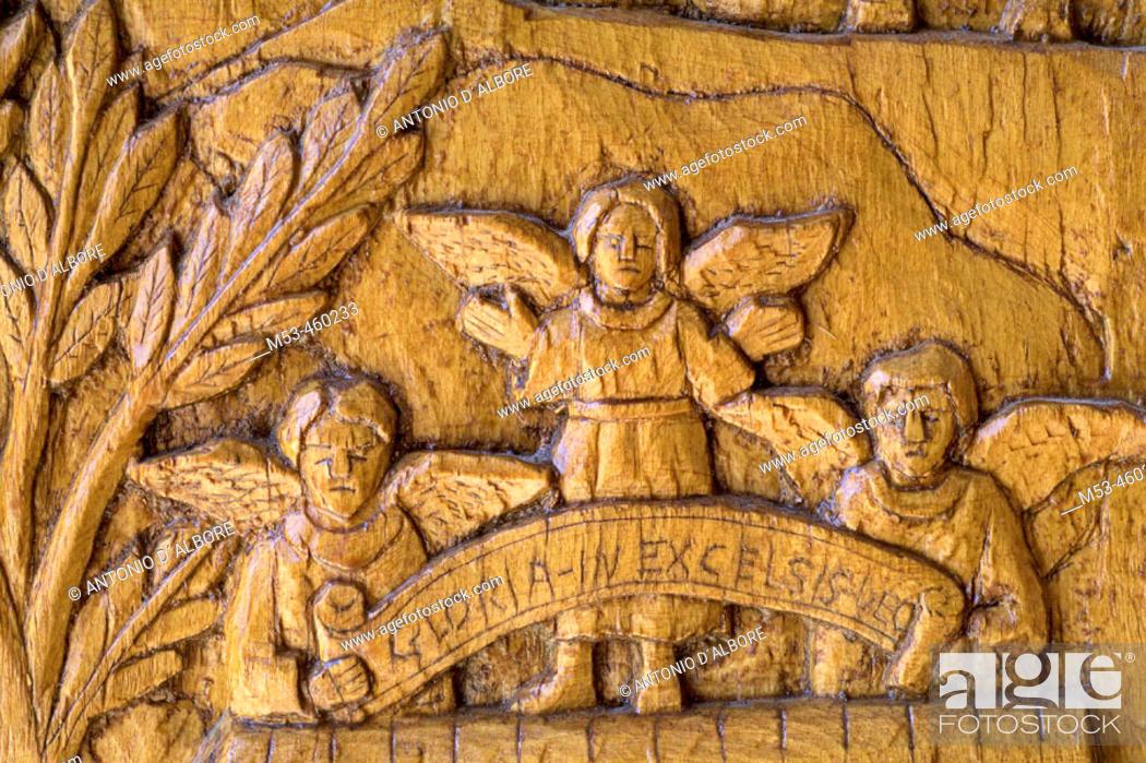 Stock Photo: Religious scene carved in the wood of the doors of the Church of San Pietro e Paolo, Pescasseroli. L'Aquila, Abruzzo, Italy.