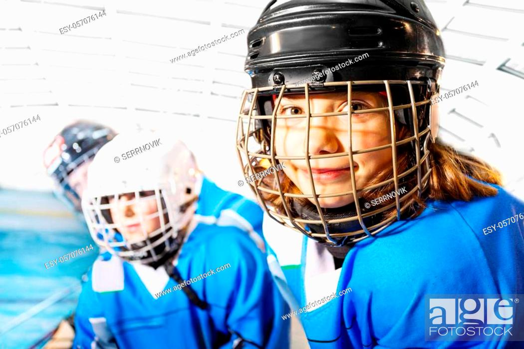 Imagen: Close-up portrait of girl in junior league wearing ice hockey uniform smiling and looking camera.