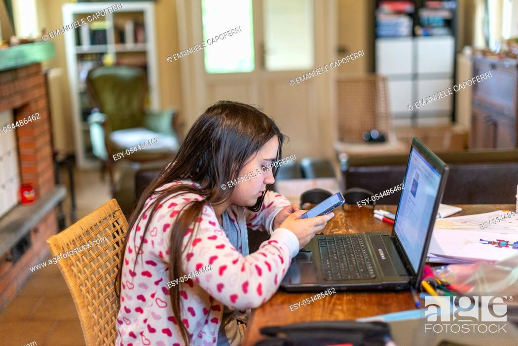 Imagen: 13 year old girl at online school lessons because of the quarantine for covid 19.
