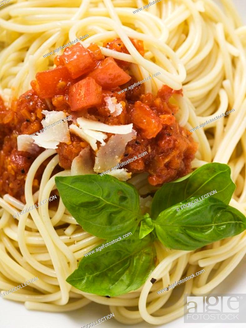 Stock Photo: Spaghetti bolognese with basil and Parmesan.