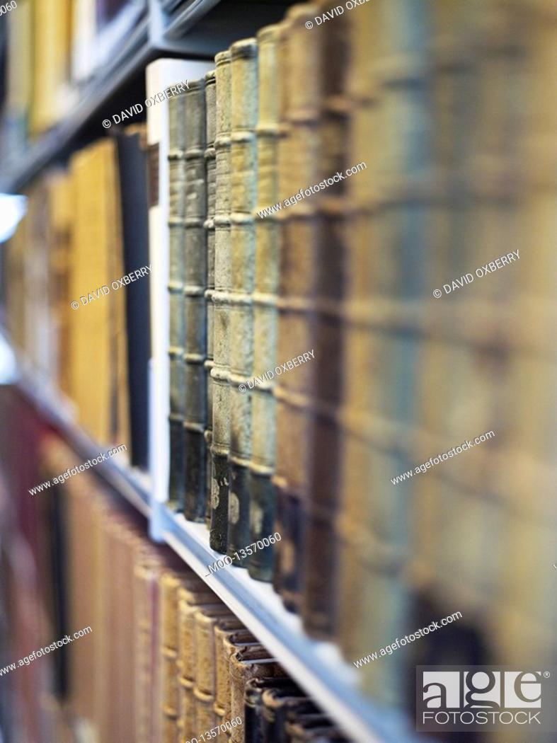 Stock Photo: Antique books on shelf.