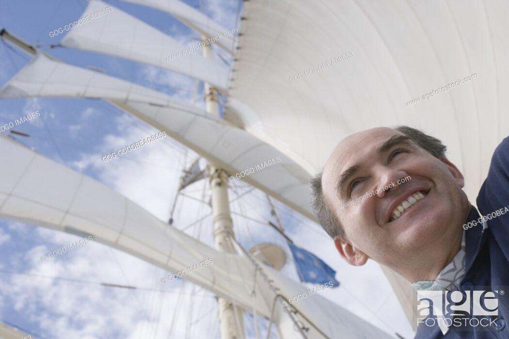 Stock Photo: Man smiling on ship deck.