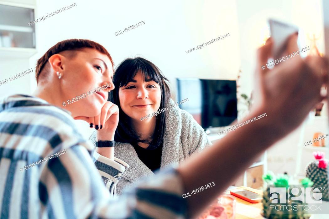 Stock Photo: Women taking selfie.