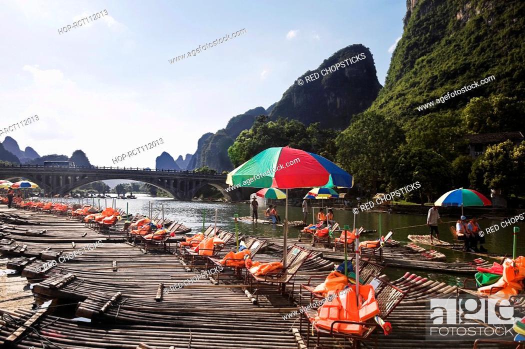 Stock Photo: Tourist resort in a river, Guilin Hills, XingPing, Yangshuo, Guangxi Province, China.