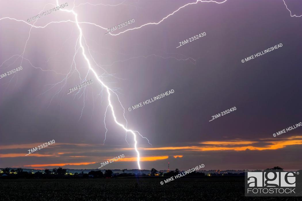Stock Photo: Lightning strikes the ground after sunset in eastern Nebraska.