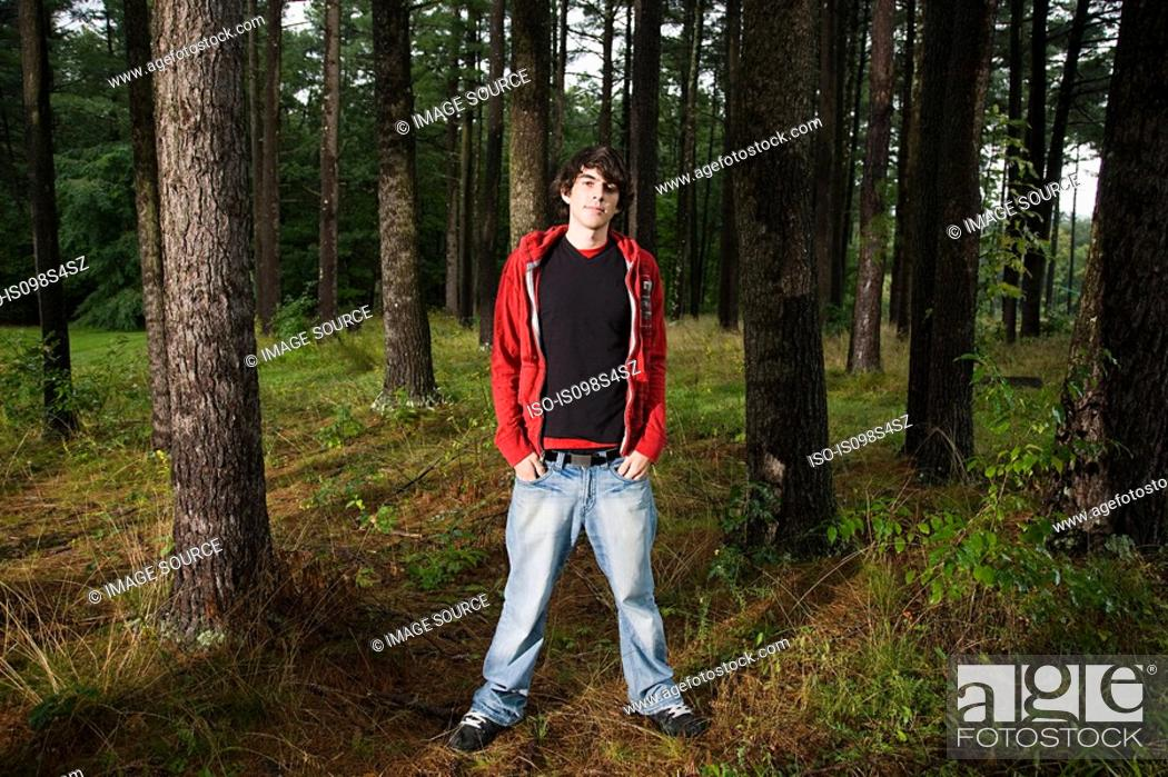 Stock Photo: Young man standing in forest.