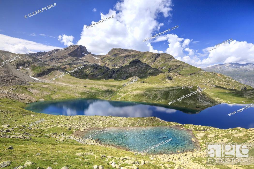 Stock Photo: Blue water of alpine lake, Leg Grevasalvas, Julierpass, Maloja, canton of Graubünden, Engadin, Switzerland.