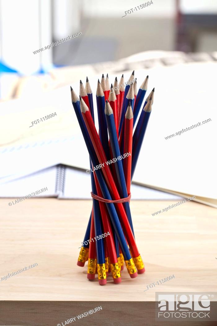Stock Photo: A bundle of sharpened pencils standing upright on an office desk.
