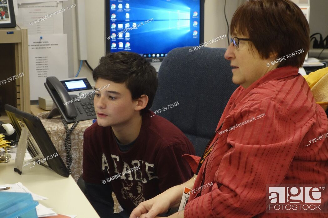Stock Photo: Special Education Teacher and Student Using iPad in Classroom, Wellsville, New York, USA.