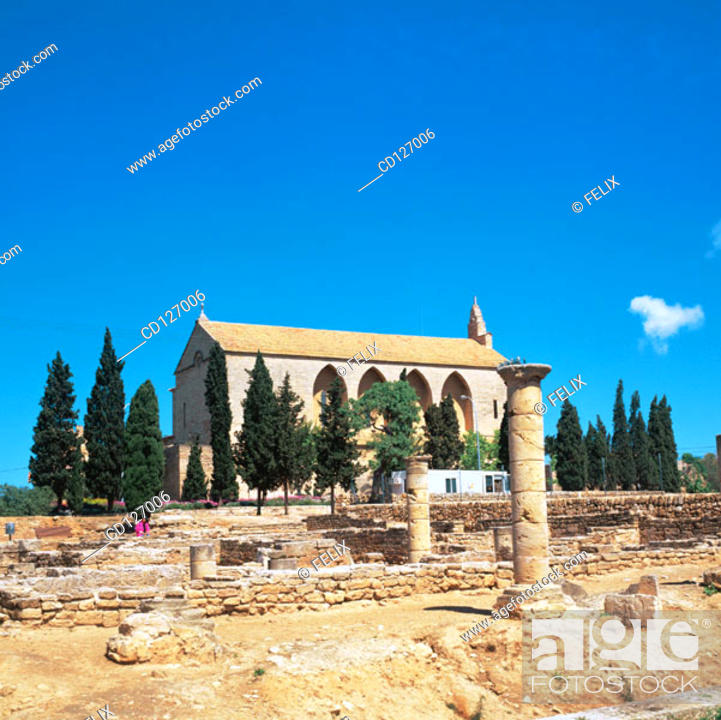 Stock Photo: Ruins of the old Roman city of Pollentia and Sant Jaume's church in background. Alcudia. Majorca. Balearic Islands. Spain.