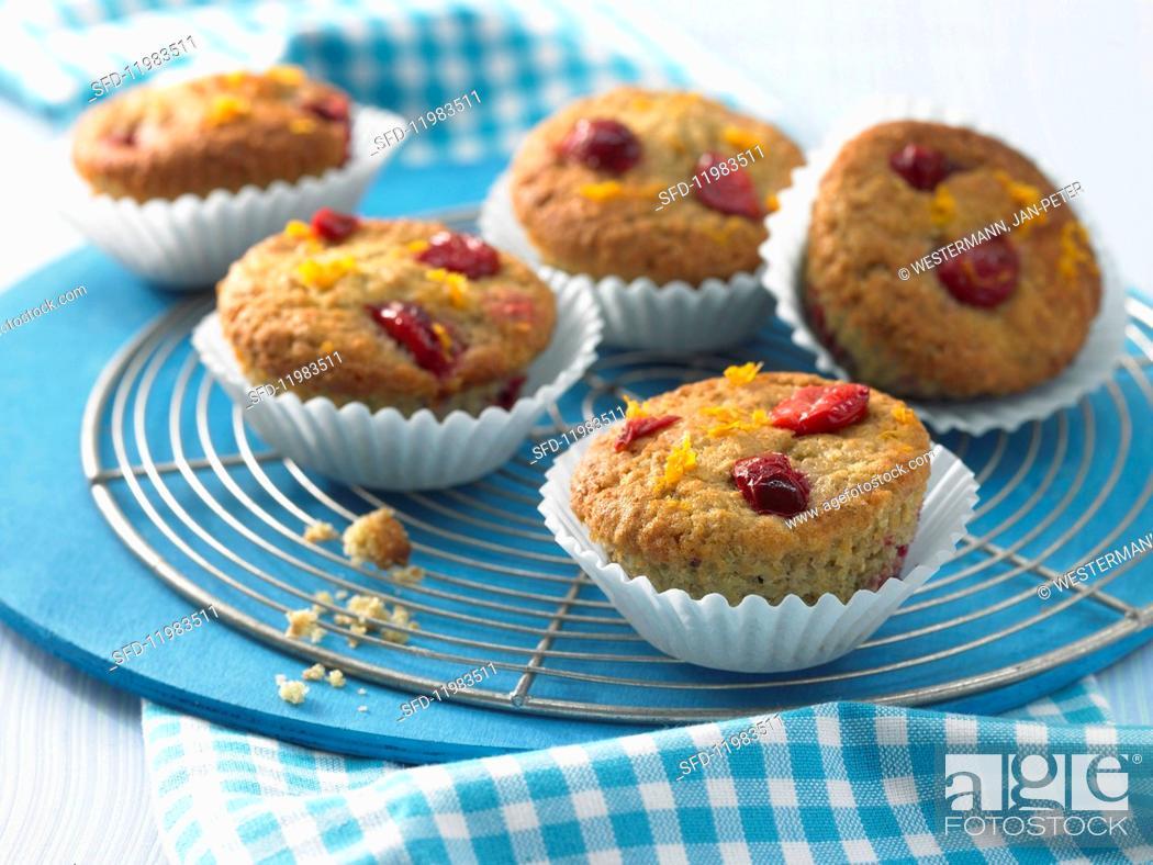 Photo de stock: Orange muffins with cherries.