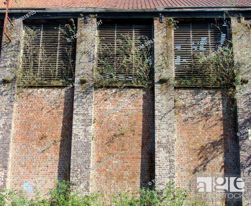 Stock Photo: large wall of an abandoned industrial building.