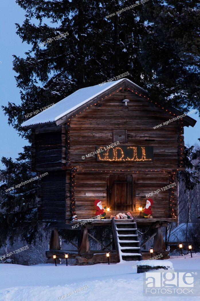 Stock Photo: Log cabin decorated with Christmas lights.