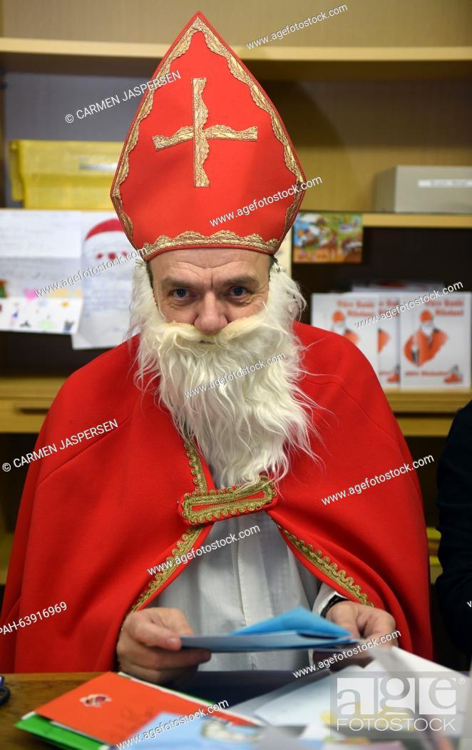 Stock Photo: 'Santa Claus' Hubert Wendehage responds to letters in the Santa Claus office in Nikolausdorf (lit. Nicholas village), Germany, 24 November 2015.