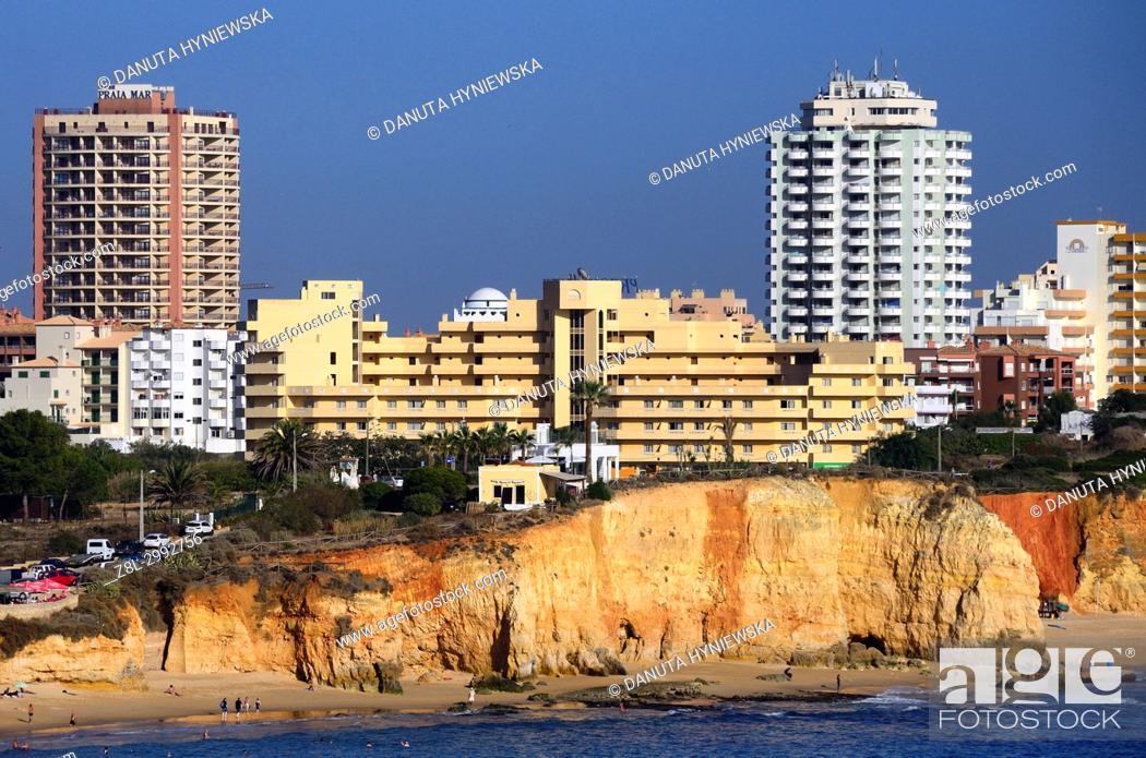 Imagen: View from Ponta João de Arens of Praia do Vau and Praia dos Careanos, hotels and apartment buildings on cliffs above beaches, coast in Portimão, Faro district.