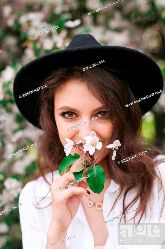 Stock Photo: Beautiful woman enjoying after relaxing outdoor, having fun, holding plant, happy young lady and spring green nature.