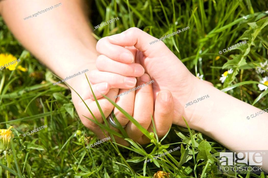 Stock Photo: Germany, Bavaria, Munich, Couple holding hands, close-up.