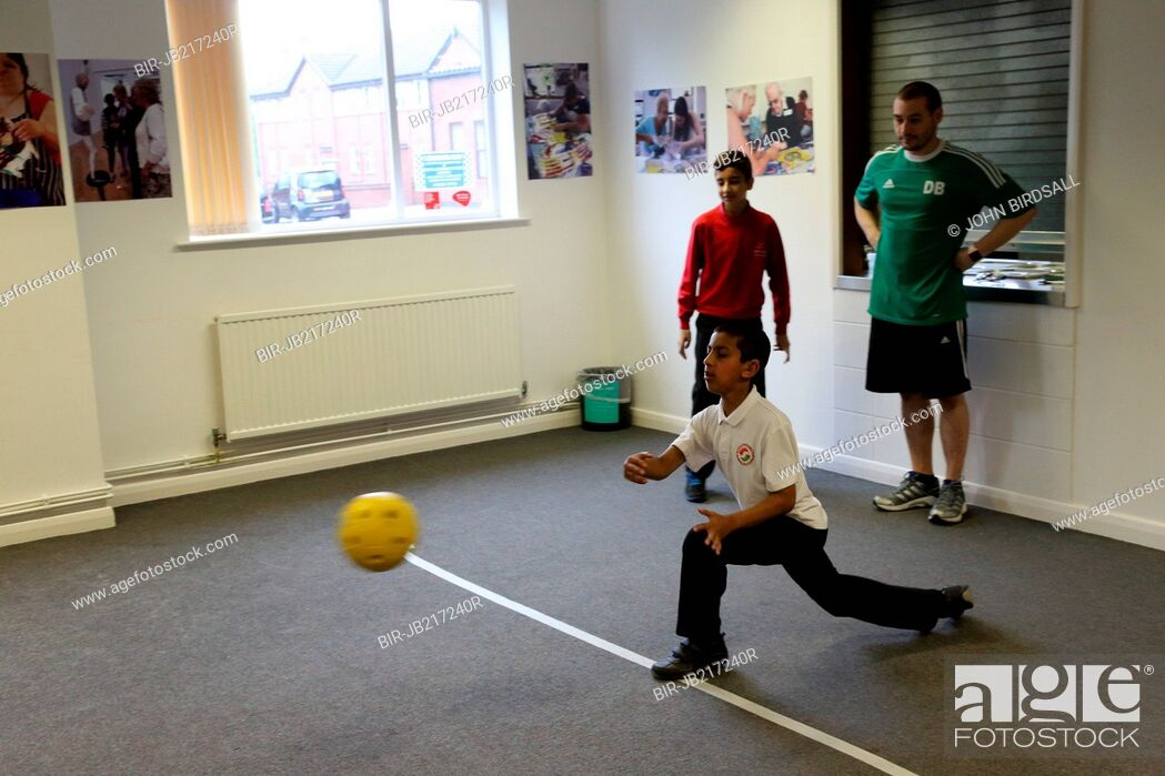 Stock Photo: Boys with visual impairments being taught Goalball at Mysight, Nottingham.